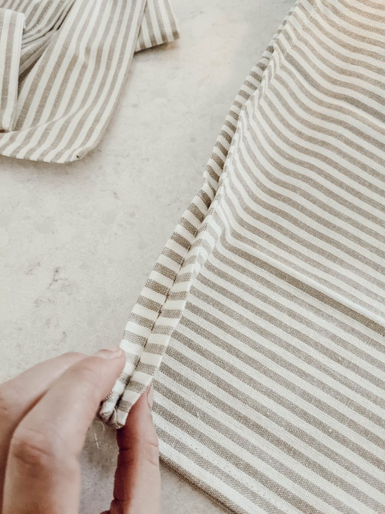 edge details of neutral striped pillow cover