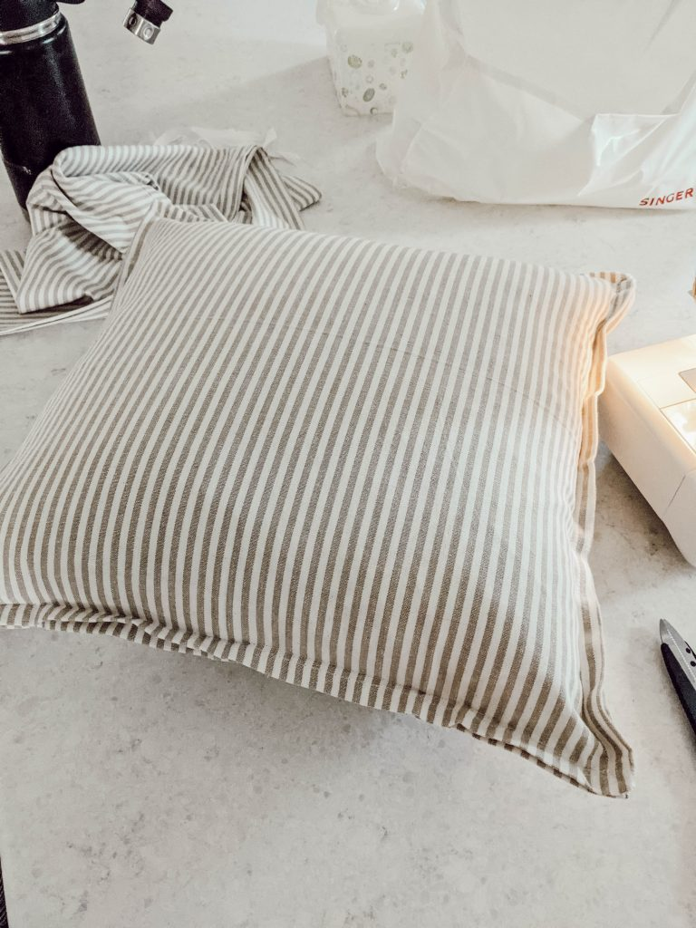 neutral tan and white striped cloth napkin pillow cover