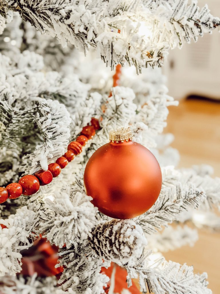 red ornaments and red beaded garland