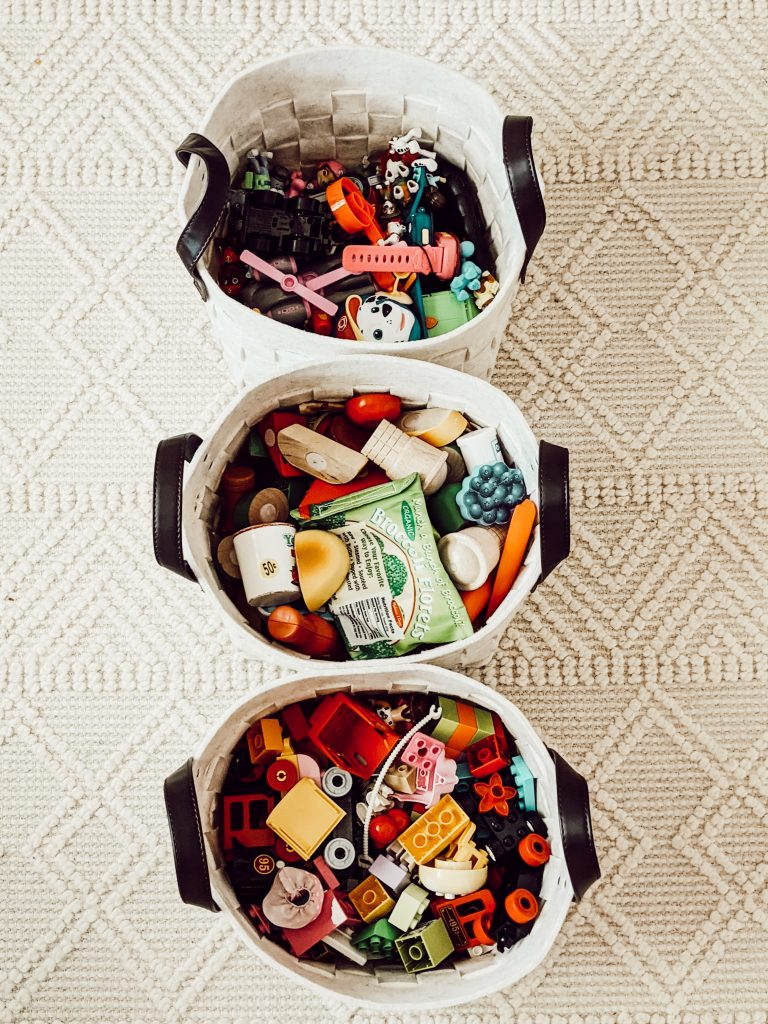 neutral playroom storage baskets filled with toys