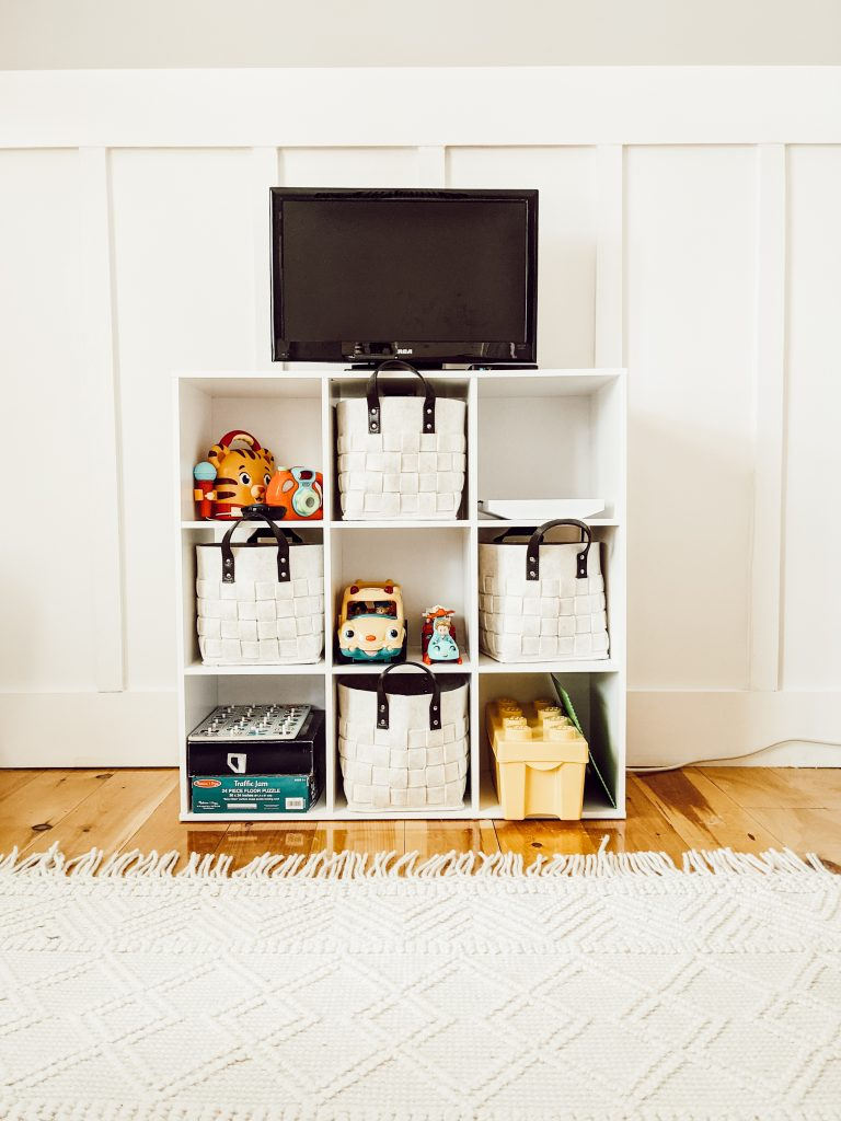 playroom cube storage with cream colored woven felt baskets from target